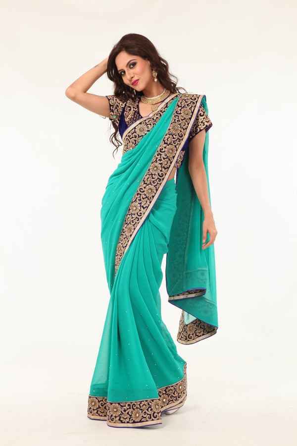 Enchanting Beauty Mint Colored Sari with Rich Blue Border