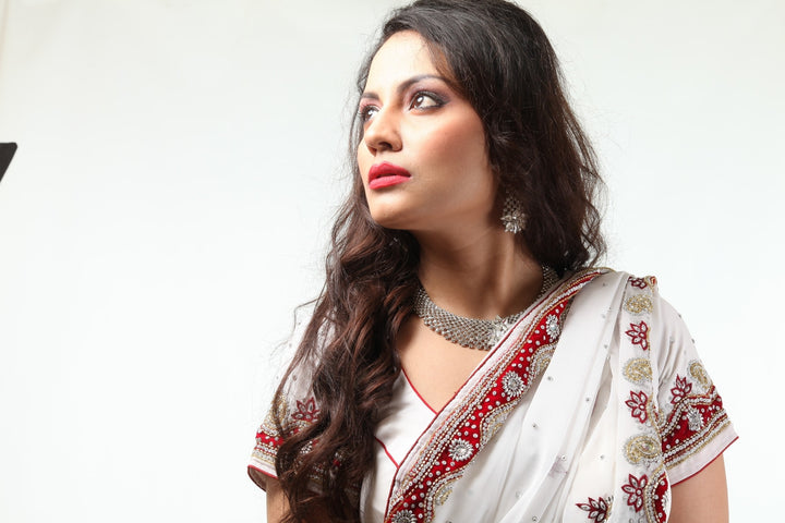 Magnificent White Beauty Rich Red Border Sari