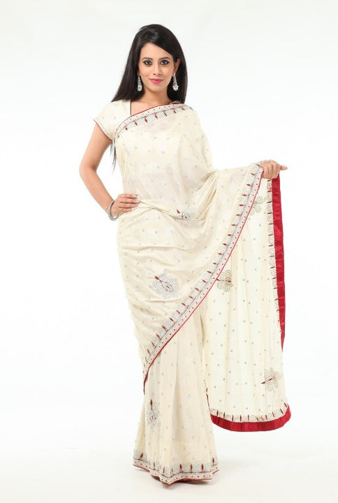 Regal in White Sari with Rich Red Border