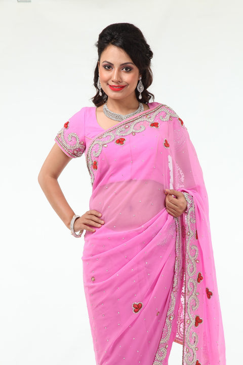 Blushing Beauty in Pink Sari with Silver Beaded Border