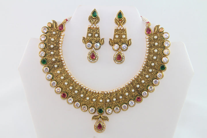 Charming Traditional Gold Kundan Necklace Set with Earrings and Tika