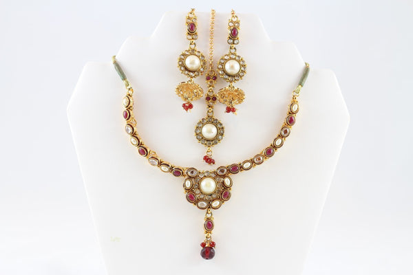 Mesmerizing Gold and Pink Kundan Necklace Set with Earrings and Tika