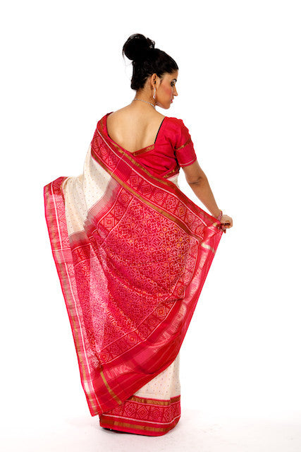 Richness Redefined in Beige and Pink Saree