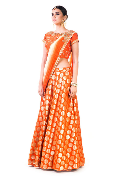 Orange Brocade Lehenga With A Chiffon Dupatta And Hand Embroidered Silk Blouse