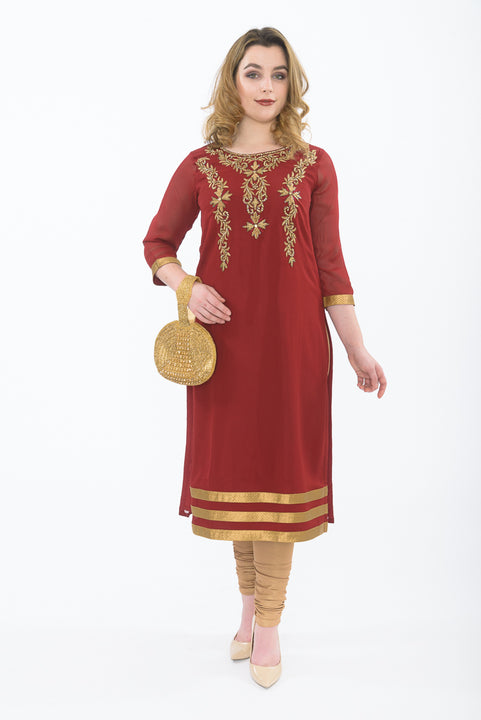 Maroon long kurti with gold leggings -Front