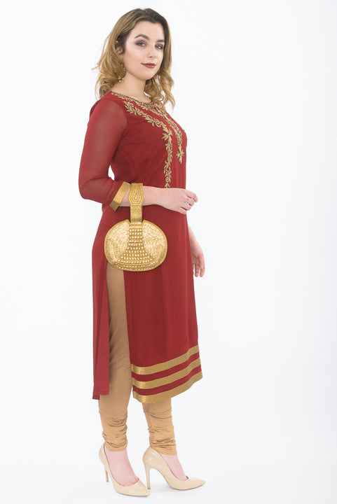 Traditional Indian Maroon long kurti with gold leggings -side