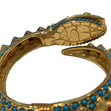 "Load image into Gallery viewer, Signed Kenneth J Lane ""KJL"" Gold Toned Red Crystal & Blue Cabochon Snake Head Clamper Bangle"