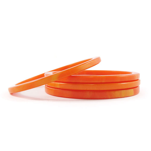 Sliced Bakelite spacer bangles c.1950's - Marbled apricot