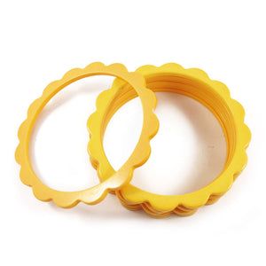 Scalloped Bakelite spacer bangles c.1950's - buttercup yellow