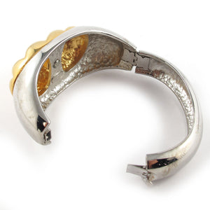 Signed 'Alexis Kirk' silver and gold tone cuff