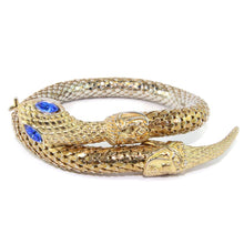 Load image into Gallery viewer, Chunky Gold Tone Snake Arm Bangle with Sapphire Blue Eyes c.1970s