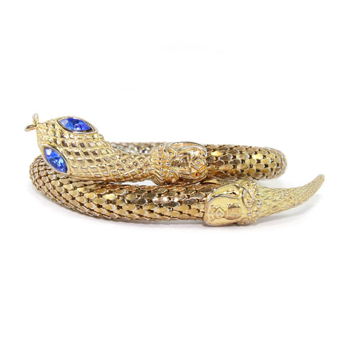 Chunky Gold Tone Snake Arm Bangle with Sapphire Blue Eyes c.1970s