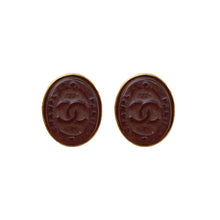 Load image into Gallery viewer, Stunning Oval Chanel Vintage Engraved CC Mahoganny Gripoix Earrings c. 1980s (Clip-on)
