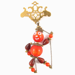 Vintage Beads Reassembled in the Form of a Puppet Brooch