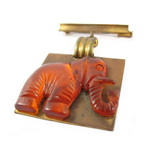 Load image into Gallery viewer, Vintage Carved Root Beer Bakelite & Brass Elephant Brooch c.1950