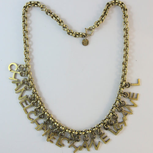 Signed Chanel Vintage Bronze Tone Charm Necklace c. 1970s