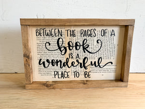 Between The Pages Of A Book Is A Wonderful Place To Be Sign