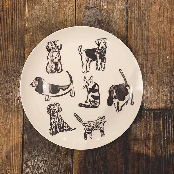 Black and white illustrated dogs and cats on a fine bone china plate. Catnap Design London.