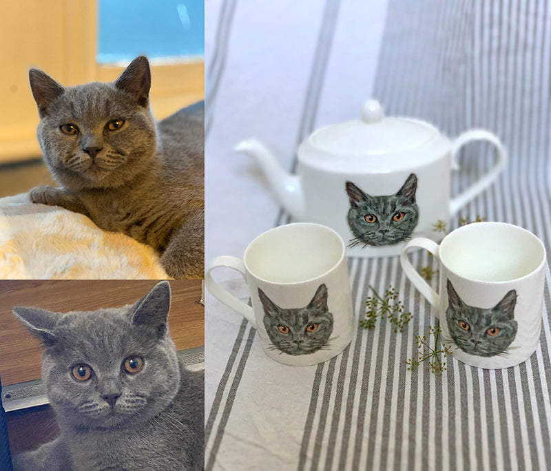 A painted cat portrait on a teapot and two mugs. Catnap Design London.