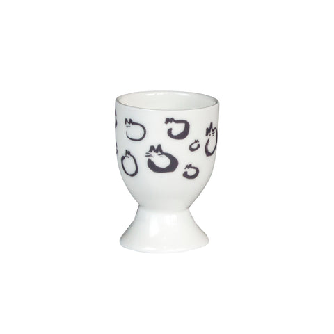A white china egg cup with a black and white cat design on it. Front view. Catnap Design London.