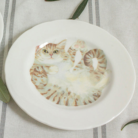 White china plate with an illustrated pale tabby cat printed on it. Gifts for cat lovers. Catnap Design London.