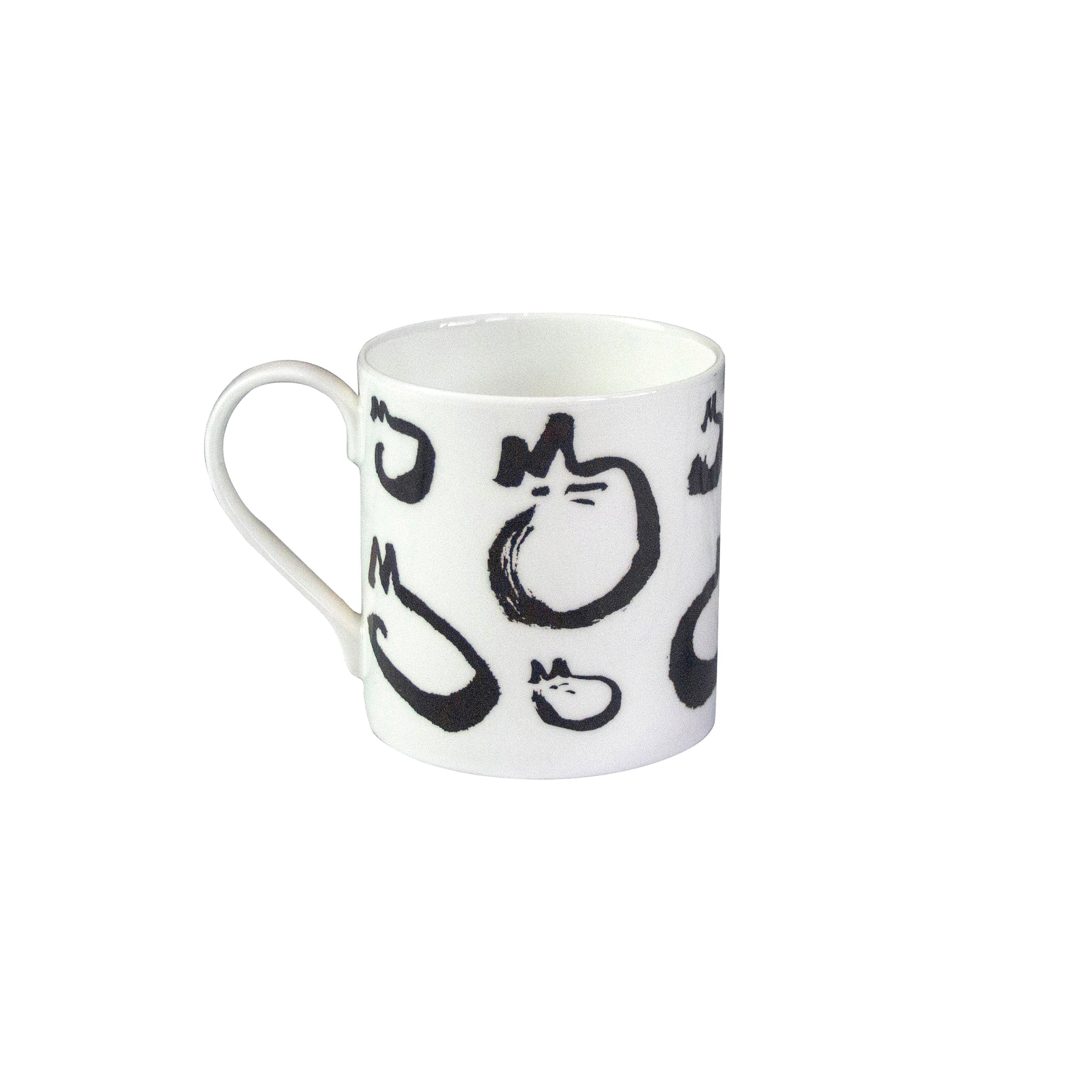 A white china mug with a black and white cat design on it. Catnap Design London.