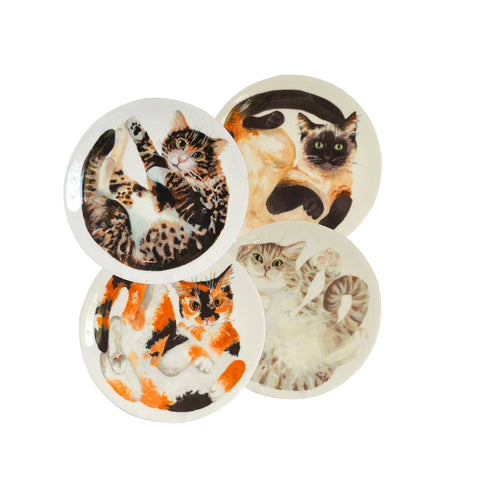 Four white china plates with two illustrated tabby cats, one tortoiseshell cat and one siamese cat illustrated on them. Mix and match dinner plates! Choose from six curled up cats to buy as a set of four! Catnap Design London