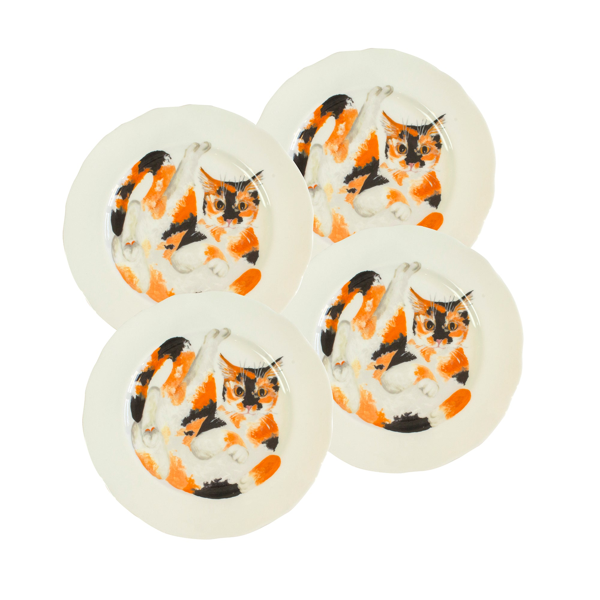 White china plates with illustrated tortoiseshell cats printed on them. Dinner plate size. Catnap Design London.