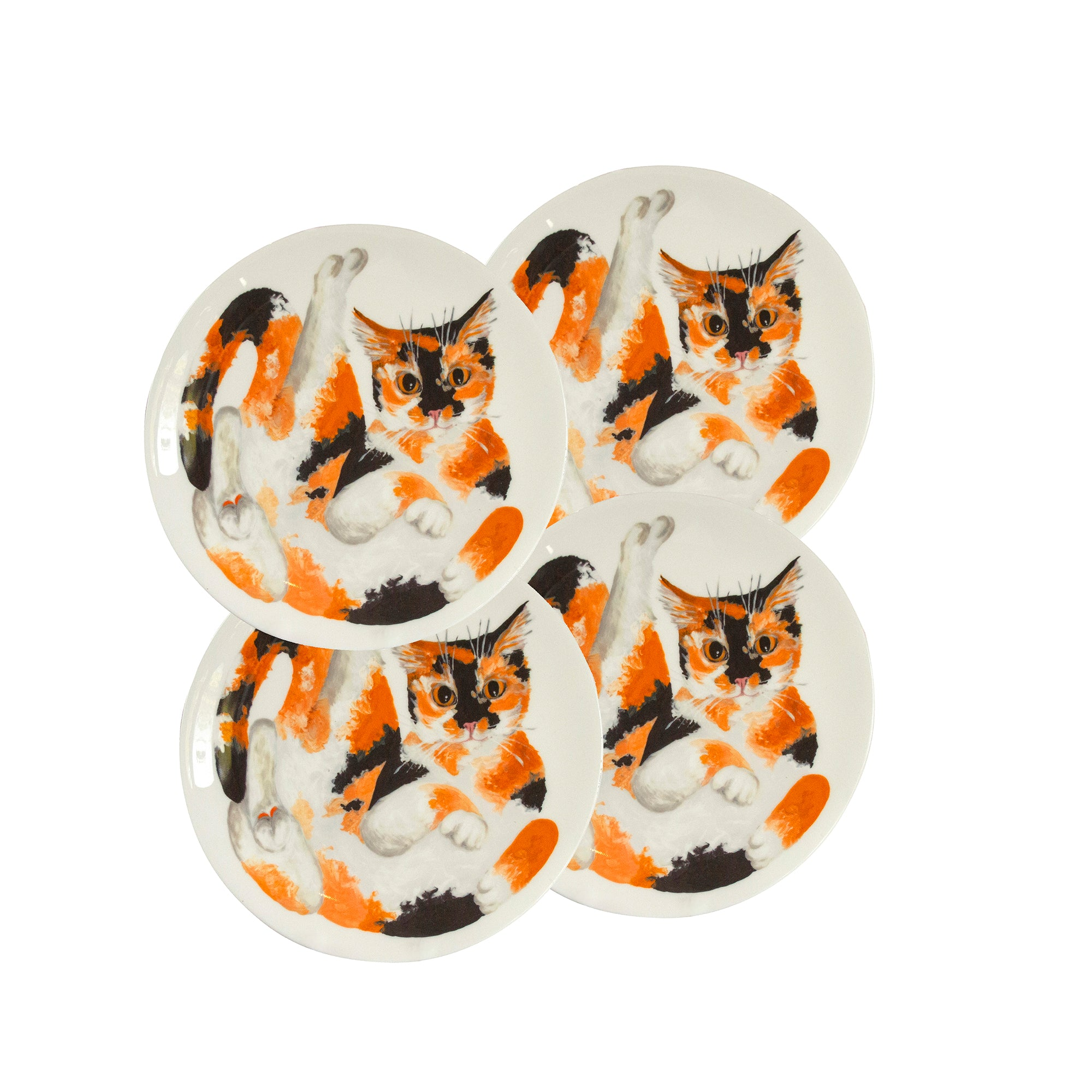 A tortoiseshell cat printed on 4 white plates. Catnap Design London.