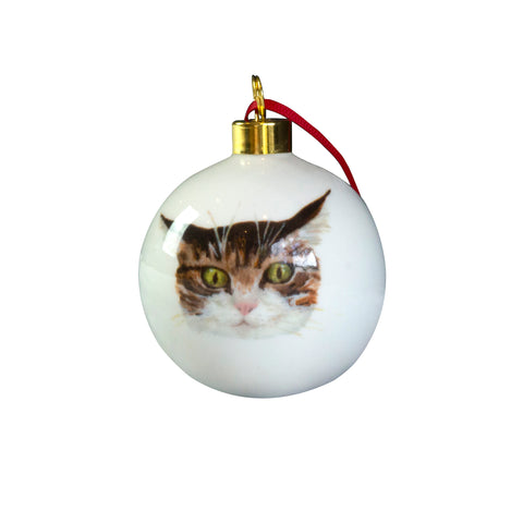 A white china bauble cup with an illustrated tabby cat face on it. Catnap Design London.