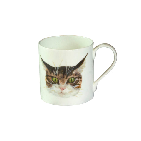 A white china mug with an illustrated tabby cat face on it. Catnap Design London.