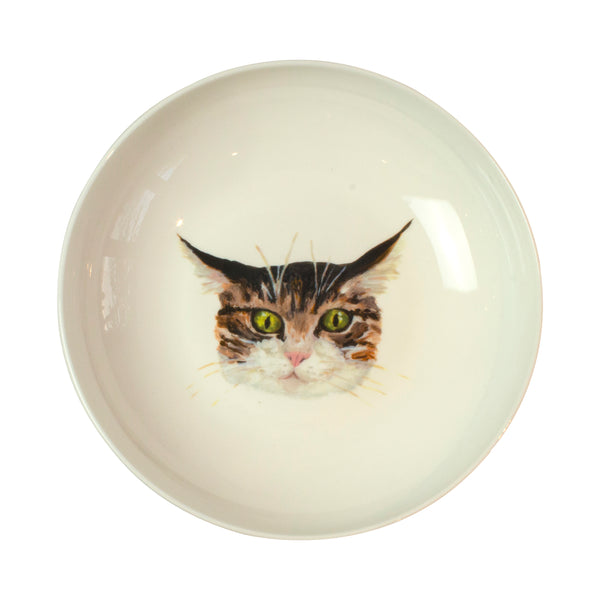 A tabby cat face on the bottom of a pasta bowl. Catnap Design London.
