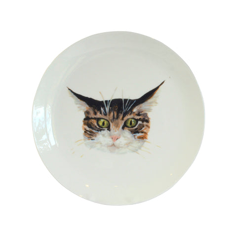 Cat face plate. A white china coupe plate with an illustrated tabby cat face on it. Catnap Design London.