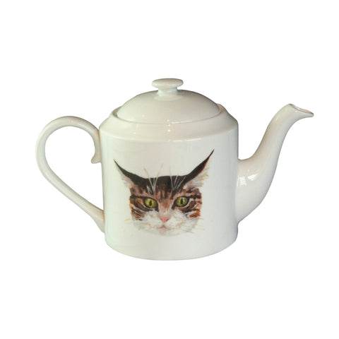 Cat face teapot. A white china teapot with an illustrated tabby cat face printed on it. Catnap Design London.