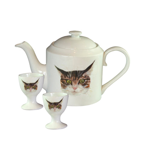 Cat teapot. A white china teapot with an illustrated tabby cat face printed on it. Catnap Design London.
