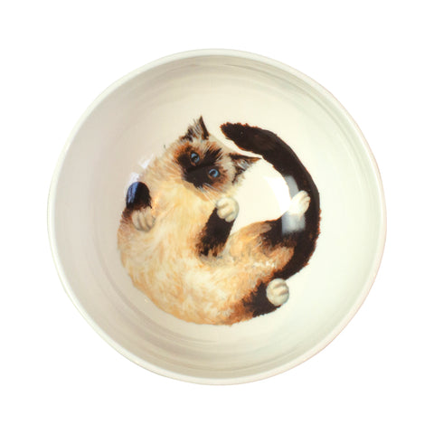 A white china cereal bowl with a Ragdoll cat pattern in the bottom. Aerial view of bowl. Catnap Design London.