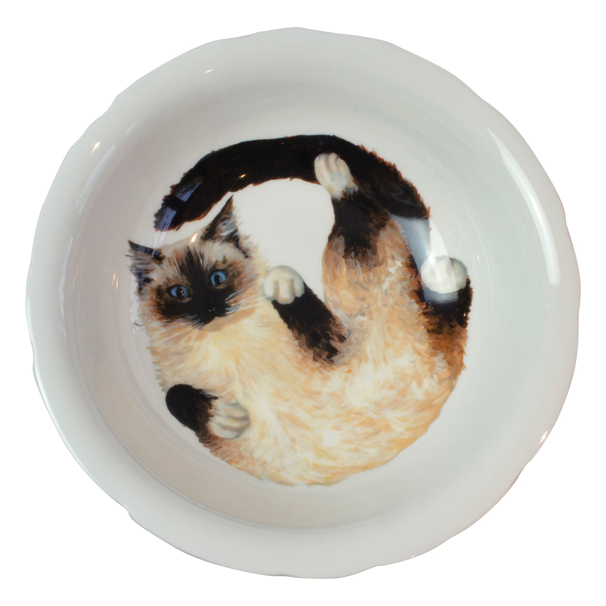 A china deep serving bowl with a Ragdoll cat pattern on the bottom of the bowl. Aerial view of bowl. Catnap Design London.