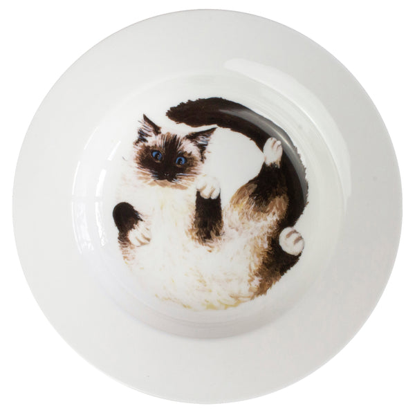 A wide china serving bowl with a Ragdoll cat pattern on the bottom of the bowl. Aerial view. Catnap Design London.