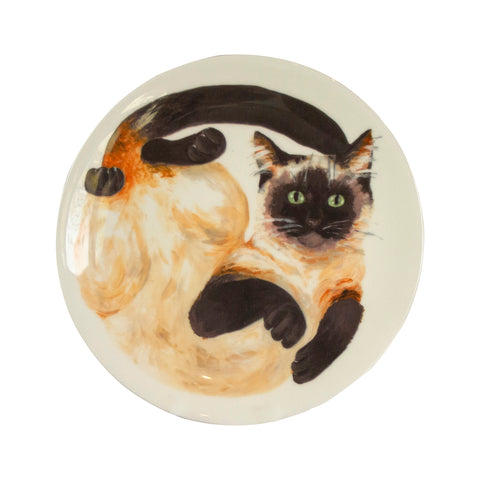 Cat plate. A white china coupe plate with an illustrated Siamese cat printed on it. Front view of plate. Catnap Design London.