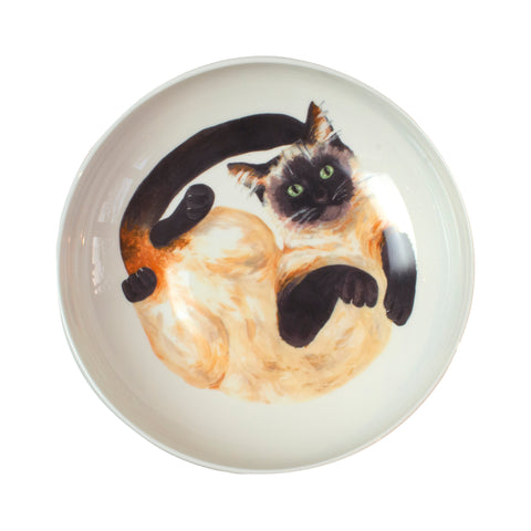 Siamese cat pattern on the bottom of a pasta bowl. Aerial view of bowl. Catnap Design London.