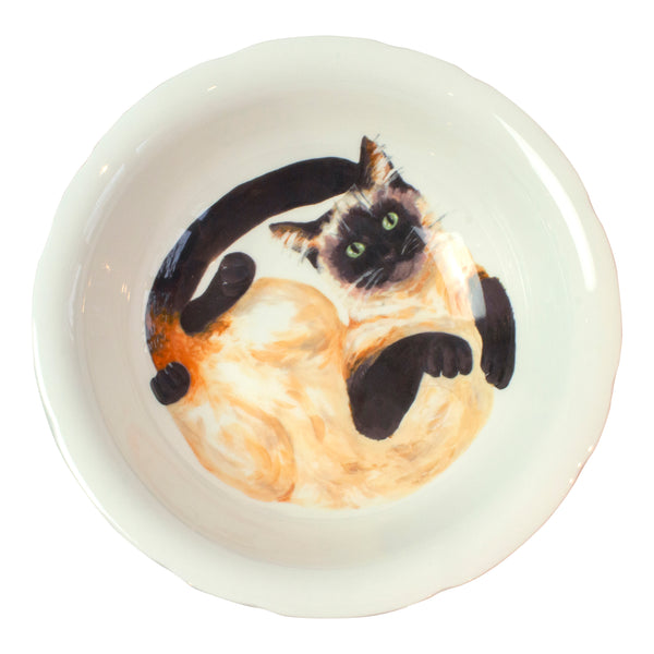 A china deep serving bowl with a Siamese cat pattern on the bottom of the bowl. Aerial view of bowl. Catnap Design London.