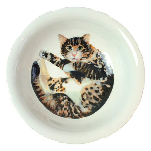 A china deep serving bowl with a tabby cat pattern on the bottom of the bowl. Aerial view of bowl. Catnap Design London.