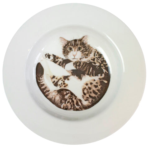A tabby cat printed on the bottom of a rimmed serving bowl. Aerial view. Catnap Design London.