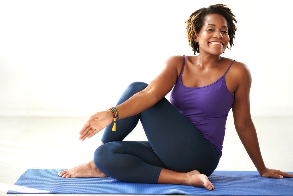 smiling woman doing yoga stretch
