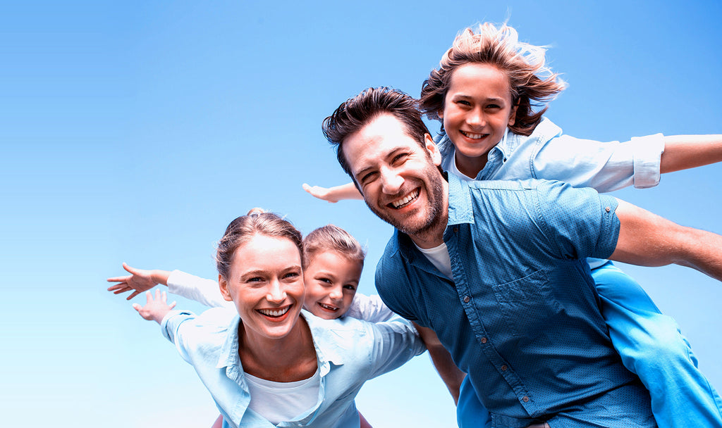 young parents and kids posed in flying position