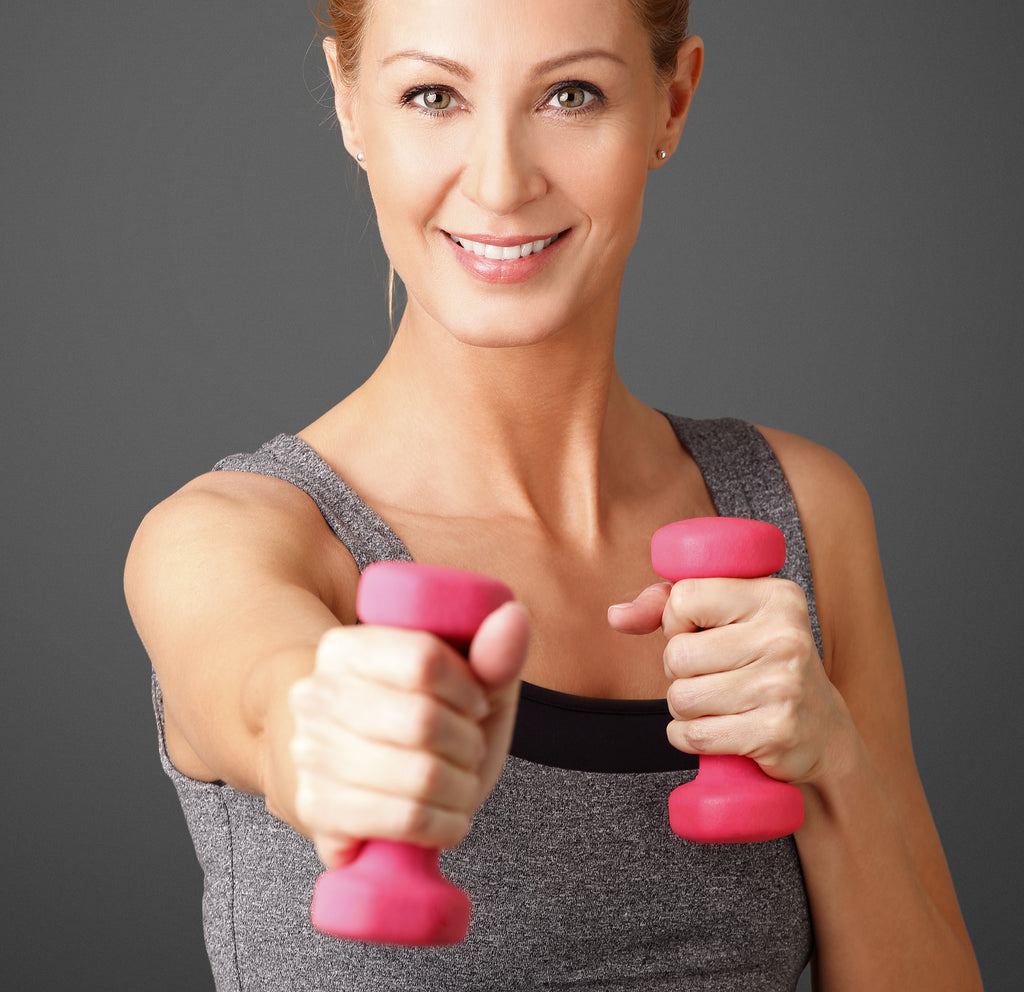 woman with pink handweights