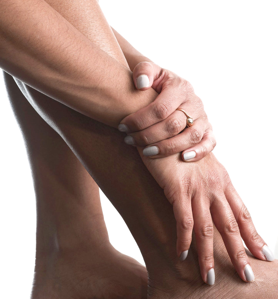 closeup of woman's hands on her legs