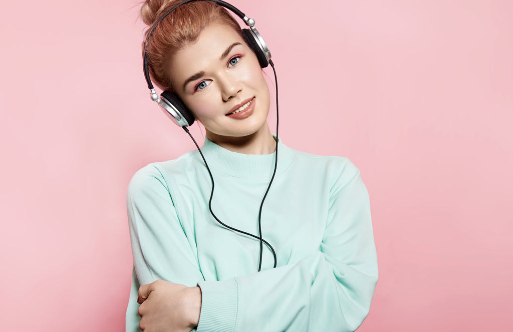 happy woman listening to music on headphones