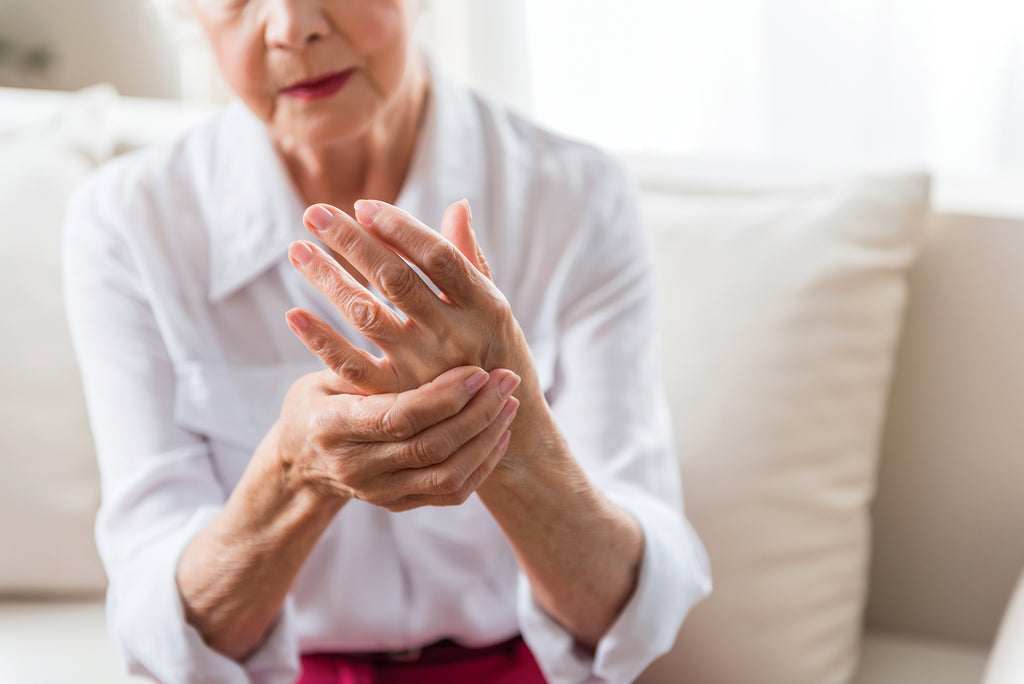 older woman rubbing her hands