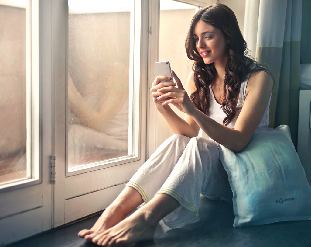 young relaxed woman with cell phone smiling